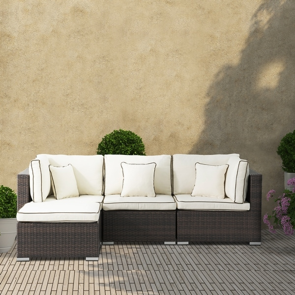 Carrington 4-piece Rattan Sectional Seating Group with Cushions and Accent Pillow. Opens flyout.