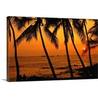 Premium Thick-Wrap Canvas entitled A couple in silhouette, enjoying a romantic sunset beneath the palm trees - Multi-color