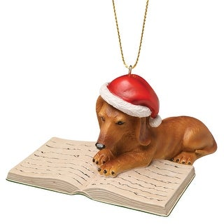 What On Earth Well-Read Dachshund Hanging Tree Ornament - Dog in Red Santa Hat Reading a Book - 4 in. x 2.5 in.