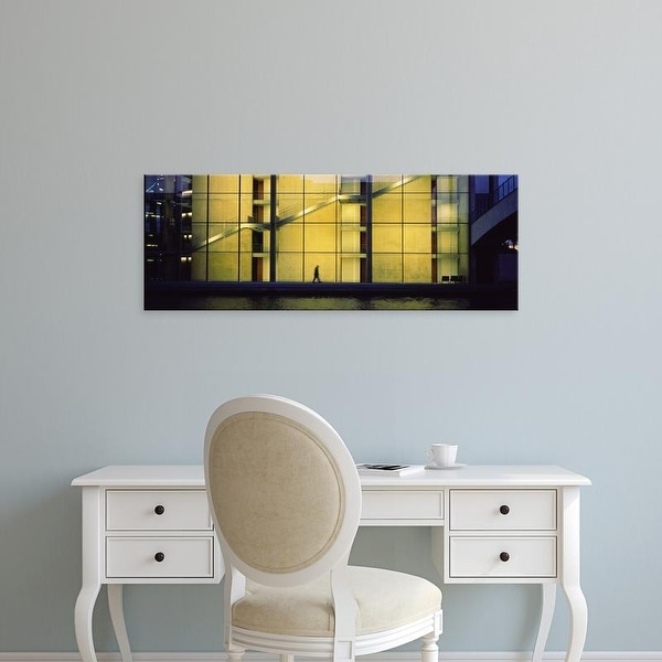 Easy Art Prints Panoramic Image 'Person walking in front of a building, Paul Lobe Haus, Berlin, Germany' Canvas Art