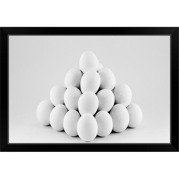 """Pyramid of white eggs on bright gray background."" Black Framed Print"