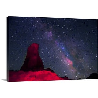 """""""Alabama Hills, rock tower painted with red light with stars and Milky way in sky"""" Canvas Wall Art"""