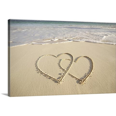 """Two overlying hearts drawn on the beach with incoming surf."" Canvas Wall Art"