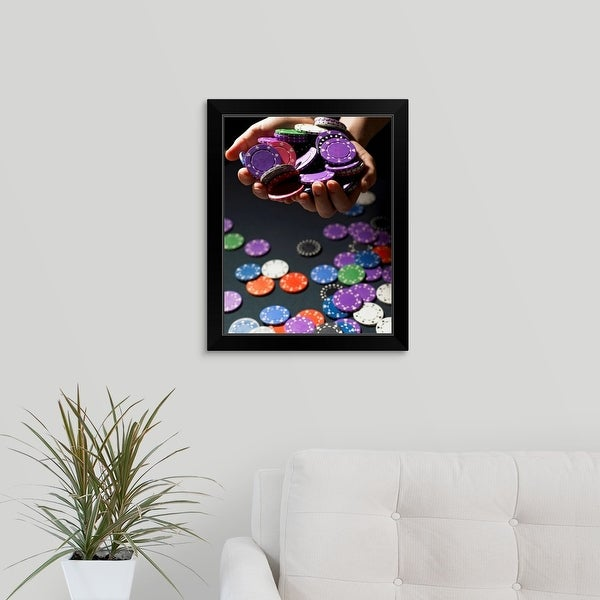 """""""Person holding handful of gambling chips, close-up"""" Black Framed Print"""
