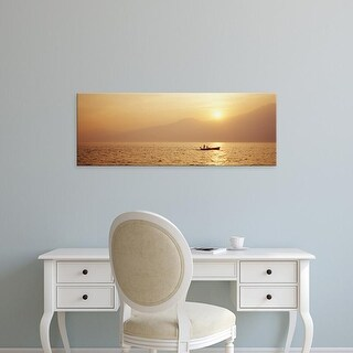 Easy Art Prints Panoramic Images's 'Silhouette of a fishing boat in a lake at sunrise, Lake Garda, Italy' Canvas Art