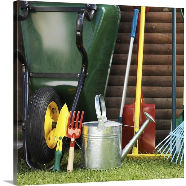 """Array of gardening tools beside a wheelbarrow in a yard"" Canvas Wall Art"