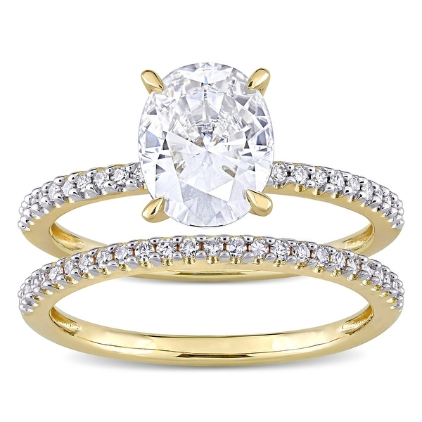 Miadora 2ct DEW Oval-Cut Moissanite and 1/4ct TDW Diamond Bridal Ring Set in 14k Yellow Gold. Opens flyout.