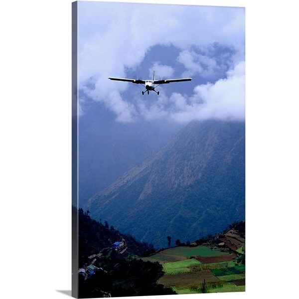 Premium Thick-Wrap Canvas entitled Twin Otter on final approach to town  -  Multi-color
