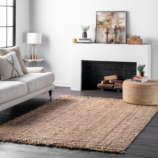 The Curated Nomad Saragossa Handmade Braided Jute Reversible Rug. Opens flyout.