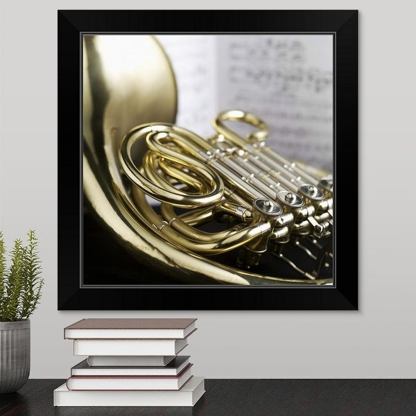 """French horn in front of sheet music"" Black Framed Print"