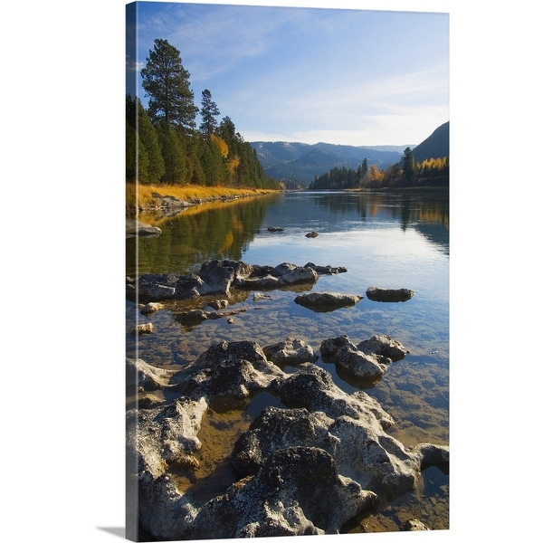 """""""Clouds and distant mountains reflected in rocky Kootenai River, Montana"""" Canvas Wall Art"""