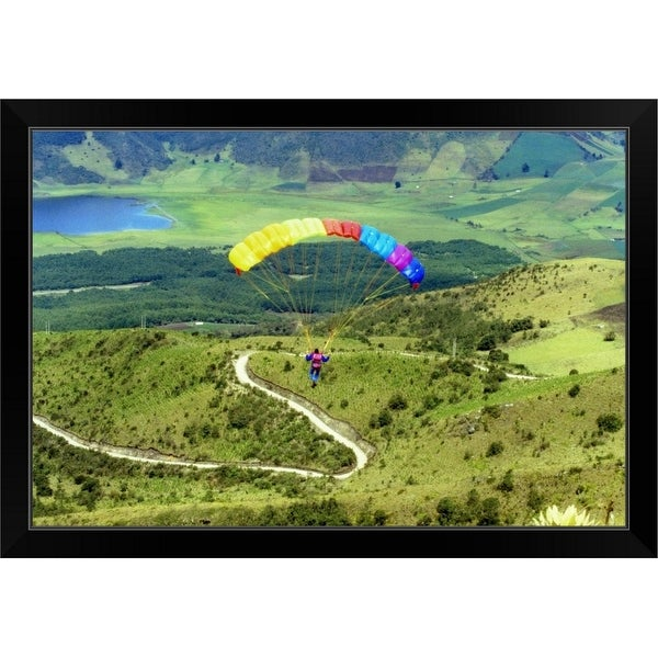 """Aerial view of a person paragliding"" Black Framed Print"