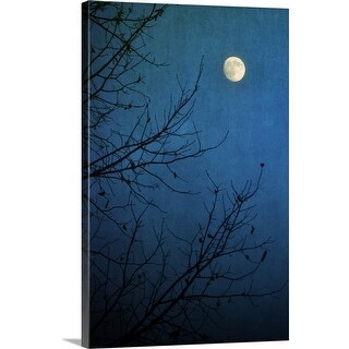 """""""Full moon in deep blue sky framed by bare branches in silhouette of leafless tree."""" Canvas Wall Art"""