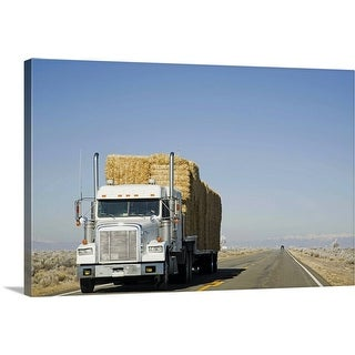 """USA, Colorado, Truck hauling hay on rural road"" Canvas Wall Art"