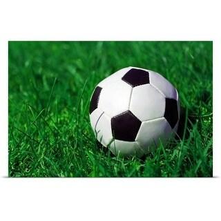 """Football on a grass field."" Poster Print"