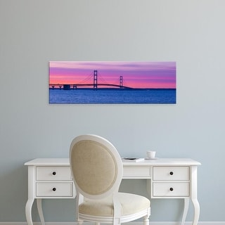 Easy Art Prints Panoramic Images's 'Silhouette of a suspension bridge at sunset, Mackinac Bridge, Michigan' Canvas Art