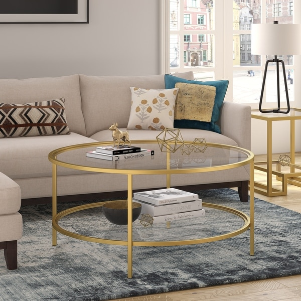 Orwell coffee table in gold with glass shelf. Opens flyout.