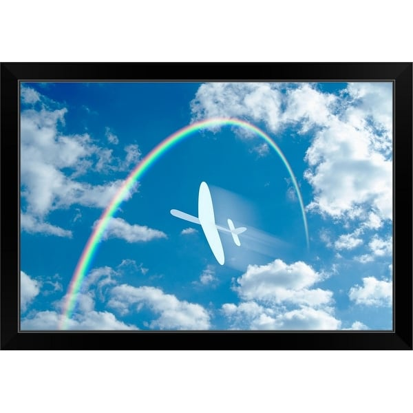"""""""Paper airplane flying through a blue sky and clouds towards a rainbow"""" Black Framed Print"""