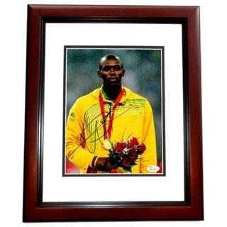Usain Bolt Signed - Autographed Jamaican Gold Medalist Track &