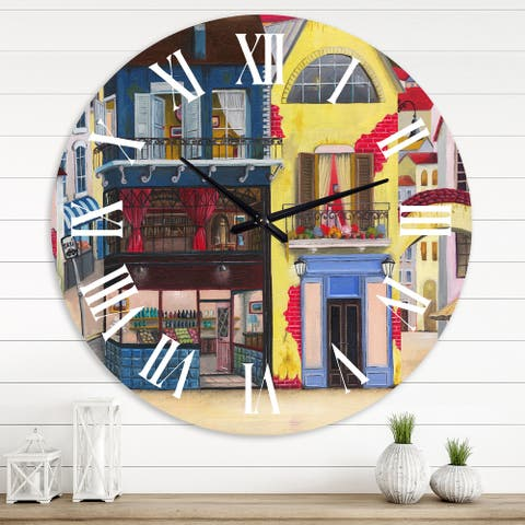 Designart 'The Facade of The Buildings In A Cozy Streets' French Country wall clock