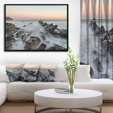 Designart 'Rocky Beach with White Waters' Modern Seashore Framed Canvas Art