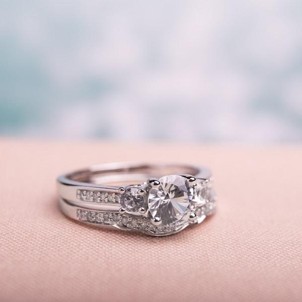 Miadora 10k White Gold Created White Sapphire and 1/6ct TDW Diamond 3-stone Bridal Ring Set (G-H, I2. Opens flyout.