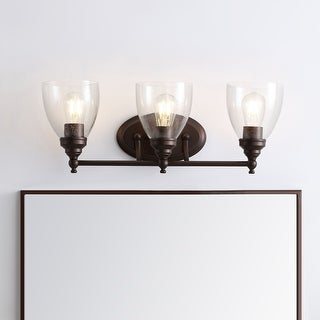 "Link to Marais 22.5"" 3-Light Metal/Glass LED Wall Sconce, Oil Rubbed Bronze by JONATHAN  Y - 60"" H x 15"" W x 15"" D Similar Items in Bathroom Vanity Lights"