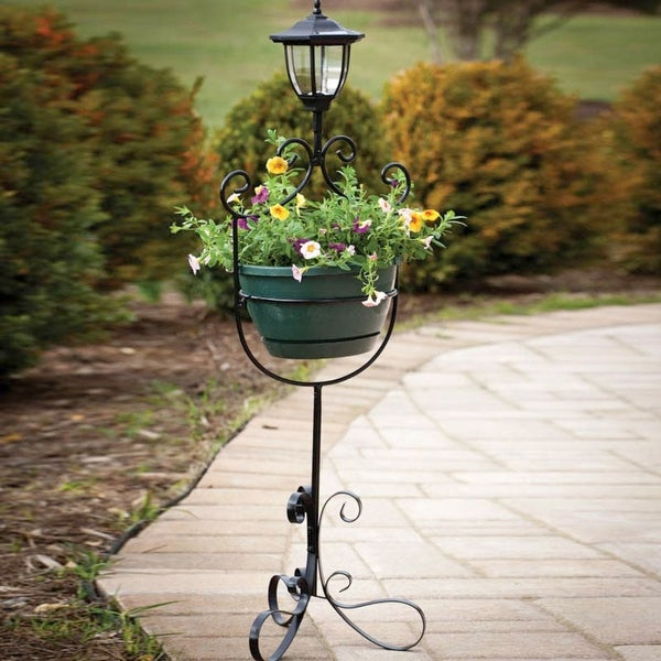 Planter with solar light. Opens flyout.