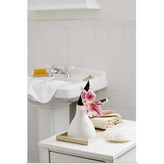 """An orchid flower in a white vase in the bathroom"" Poster Print"