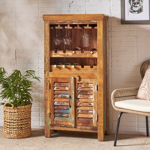 Laverock Boho Handcrafted Wooden Bar Cabinet by Christopher Knight Home. Opens flyout.