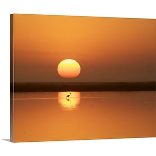Premium Thick-Wrap Canvas entitled Heron walking in the sun's reflection