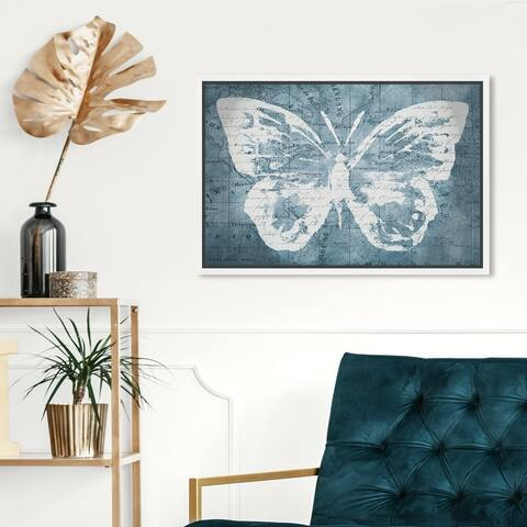 Oliver Gal 'Traveling Blue Butterfly' Animals Wall Art Framed Canvas Print Insects - Blue, White