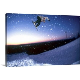 """""""Low angle view of a man snowboarding"""" Canvas Wall Art"""