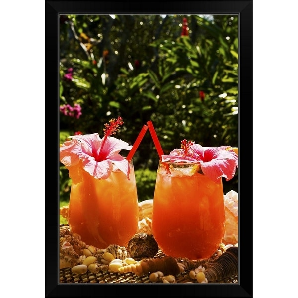 """""""Two tropical drinks garnished with flowers in an outdoor setting."""" Black Framed Print"""