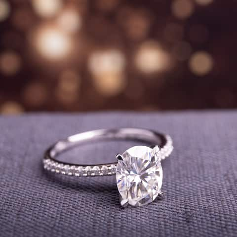 Miadora 2ct DEW Oval-cut Moissanite and 1/10ct TDW Diamond Engagement Ring in 14k White Gold