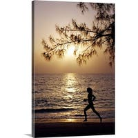 Premium Thick-Wrap Canvas entitled Runner on Seven Mile Beach, Grand Cayman - Multi-color