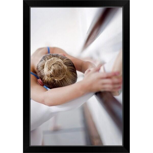 """""""Ballet dancer stretching at barre"""" Black Framed Print"""