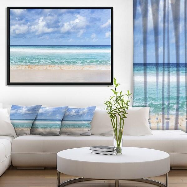 Designart 'Tranquil Beach under White Clouds' Modern Seascape Framed Canvas Artwork Print. Opens flyout.
