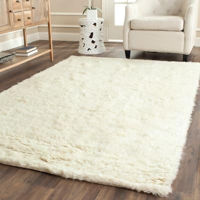 SAFAVIEH Handmade Flokati Tonda Shag Solid Wool Rug