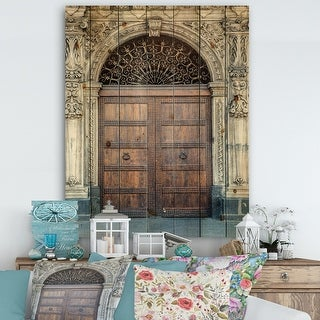 Link to Designart 'Old Door in Catania, Italy' Vintage Print on Natural Pine Wood - Brown Similar Items in Wood Wall Art