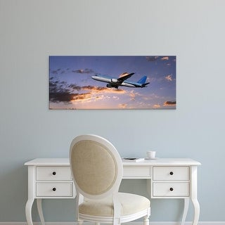 Easy Art Prints Panoramic Images's 'Low angle view of an airplane in flight' Premium Canvas Art