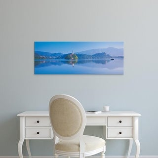 Easy Art Prints Panoramic Images's 'Reflection of mountains and buildings in water, Lake Bled, Slovenia' Canvas Art