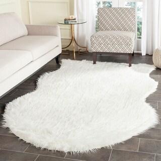 Link to Safavieh Faux Sheep Skin Mellisa Shag Solid Rug Similar Items in Shag Rugs