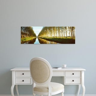 Easy Art Prints Panoramic Images's 'Belgium, tree lined waterway through countryside' Premium Canvas Art