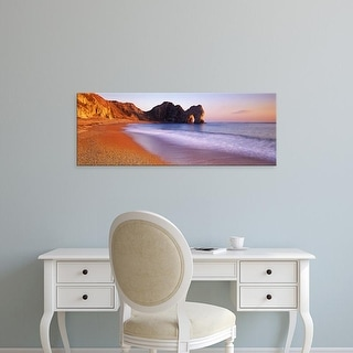Easy Art Prints Panoramic Images's 'Rock formations on the seaside, Durdle Door, Dorset, England' Premium Canvas Art