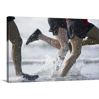 """Men running in ocean, low section"" Canvas Wall Art"