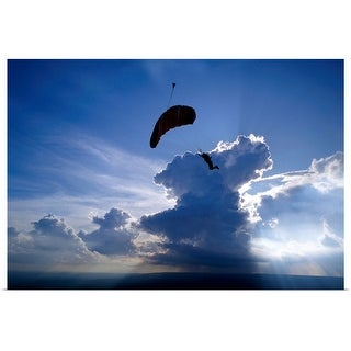 """Silhouette of a person paragliding"" Poster Print"