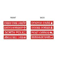 "Pack of 12 North Pole Street Sign Cutout Christmas Decorations 4"" x 2'"