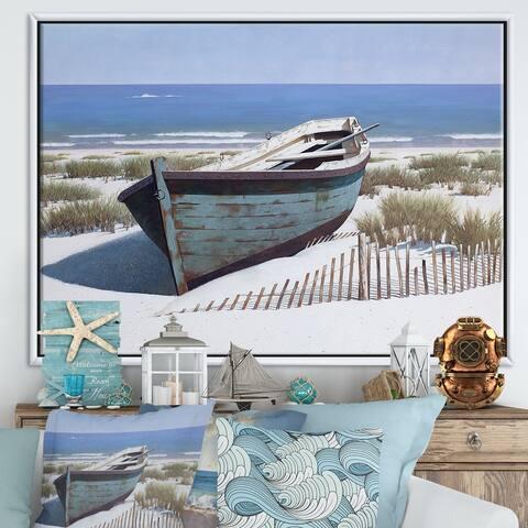 Designart 'Blue Boat on Beach' Nautical & Coastal Framed Canvas Artwork Print