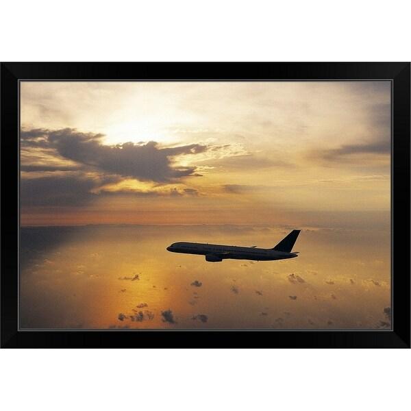 """Commercial Aeroplane Flying Above the Sea at Dusk"" Black Framed Print"